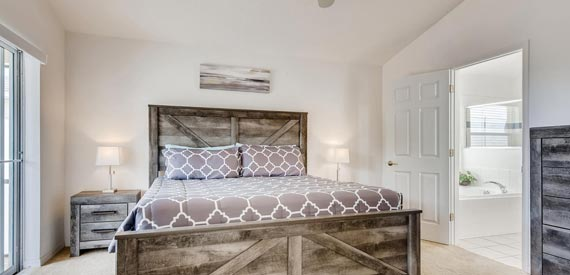 Master Bedroom with ensuite Bathroom inside Highgate Sunshine Villa Orlando, Florida